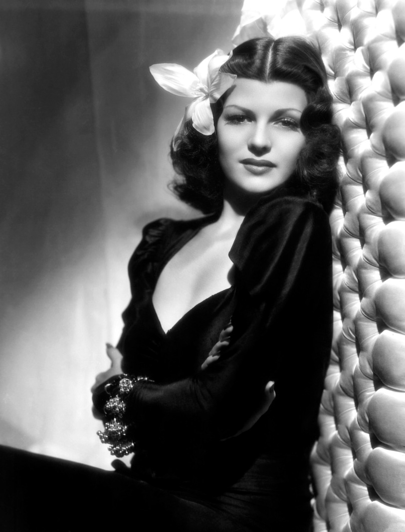 1940: American actress Rita Hayworth (1918 -1987) with an exotic flower in her hair. (Photo by A. L. Whitey Schafer)